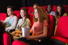 Young friends watching a film Royalty Free Stock Photography