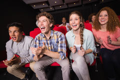 Young friends watching a film Stock Photo