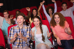 Young friends watching a film Royalty Free Stock Photos