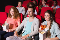 Young friends watching a film Stock Photos