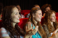 Young friends watching a film Royalty Free Stock Photo