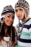 Young friends with woolen cap Royalty Free Stock Images