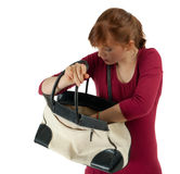Young, frightened woman looking to bag Stock Photo