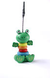 Young frog toy. Figure of a young frog \of a paper clip onthe white background Stock Photo