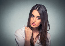 Young frustrated angry woman with fist up in air royalty free stock photography