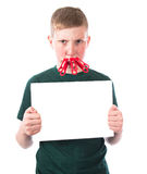 Young and frustrated boy with clothespins on his lips holds in hands an empty plate stock photography
