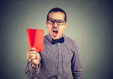 Frustrated business man manager showing a red card screaming at camera stock images