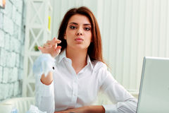 Young frustrated businesswoman throwing paper Stock Image