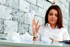 Young frustrated businesswoman throwing paper Royalty Free Stock Photo
