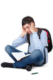Young frustrated and tired male student learns. Young male student learning frustrated and tired for exam. Isolated on white background Stock Photography