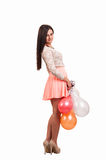 Young full body woman with balloons as a present for birthday pa Royalty Free Stock Images
