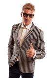 Young funky businessman showing thumbs up Royalty Free Stock Images