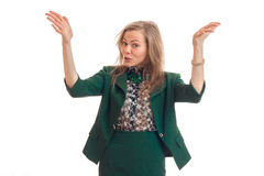 Young funny blonde in a green suit raised two hands up and surprised Royalty Free Stock Photos