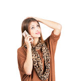 Young funny bored woman talking on the mobile phone Royalty Free Stock Images