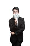 Young funny business man holding money Stock Images