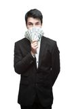 Young funny business man holding money Stock Photos