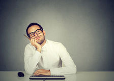Young funny business man thinking daydreaming Royalty Free Stock Photography