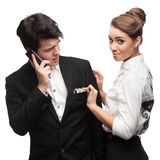 Young funny business people holding money Royalty Free Stock Photos