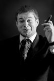 Young  funny  businessman with cigar Stock Images