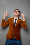 Young funny businessman on grey background Royalty Free Stock Image