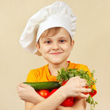 Young funny chef with fresh vegetables Stock Photo