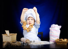 Young funny cook with kitchenware. Photo of young funny cook with kitchenware Royalty Free Stock Image