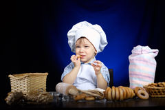 Young funny cook with kitchenware. Photo of young funny cook with kitchenware Royalty Free Stock Photos