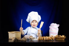 Young funny cook with kitchenware. Photo of young funny cook with kitchenware Royalty Free Stock Images