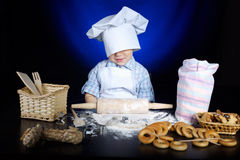 Young funny cook with kitchenware. Photo of young funny cook with kitchenware Royalty Free Stock Photography