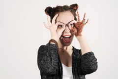Young funny and cute hipster woman smiling and joking and making spectacles from her hands. Royalty Free Stock Photos