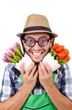 Young funny gardener with tulips isolated oin Stock Image
