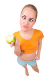 Young funny girl with apple Royalty Free Stock Image