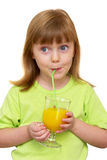 Young funny girl with a glass of juice Royalty Free Stock Image