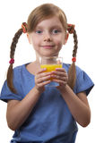 Young funny girl with a glass of juice Royalty Free Stock Photos