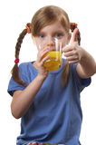 Young funny girl with a glass of juice Stock Photo