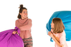 Young funny girls fighting with beanbag chairs Stock Photos
