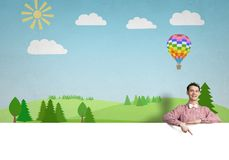 Cheerful man with banner Stock Images