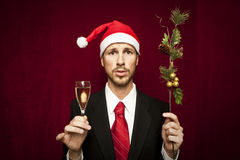 Young funny guy with christmas hat Stock Photos