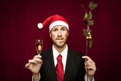 Young funny guy with christmas hat Royalty Free Stock Image