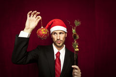 Young funny guy with christmas hat Royalty Free Stock Images