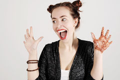 Young funny hipster woman showing tongue, shouting and surprise with funny emotion face. royalty free stock photos