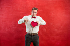 Young funny man with abstract heart and clock