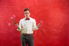 Young funny man with broken bouquet Stock Photography