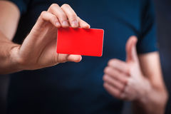 Young funny man with business card for the holiday 03 Stock Photos