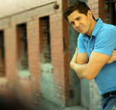 Young Funny Man Folding Arms. Portrait of young good looking male model with folded arms while winking Stock Photos