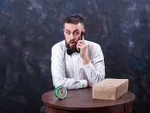 Young funny man with gift is preparing for the holiday 15 Royalty Free Stock Photo