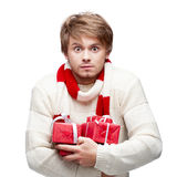 Young funny man holding christmas gifts Stock Photography