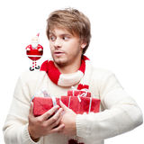 Young funny man holding christmas gifts Stock Image