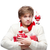 Young funny man holding christmas gifts Royalty Free Stock Photos