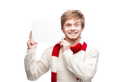 Young funny man holding sign. Portrait of young funny cheerful caucasian man which holding sign with funny expression Royalty Free Stock Images
